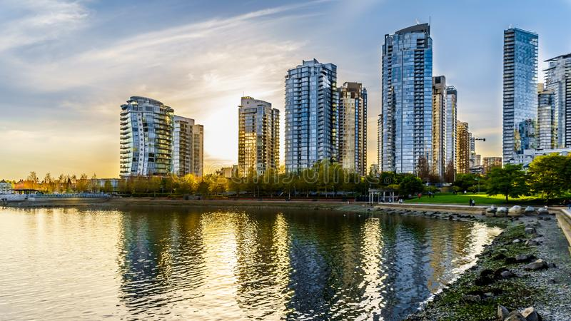 Sunset as the sun is setting behind modern Skyscapers lining the skyline of Yaletown royalty free stock photos