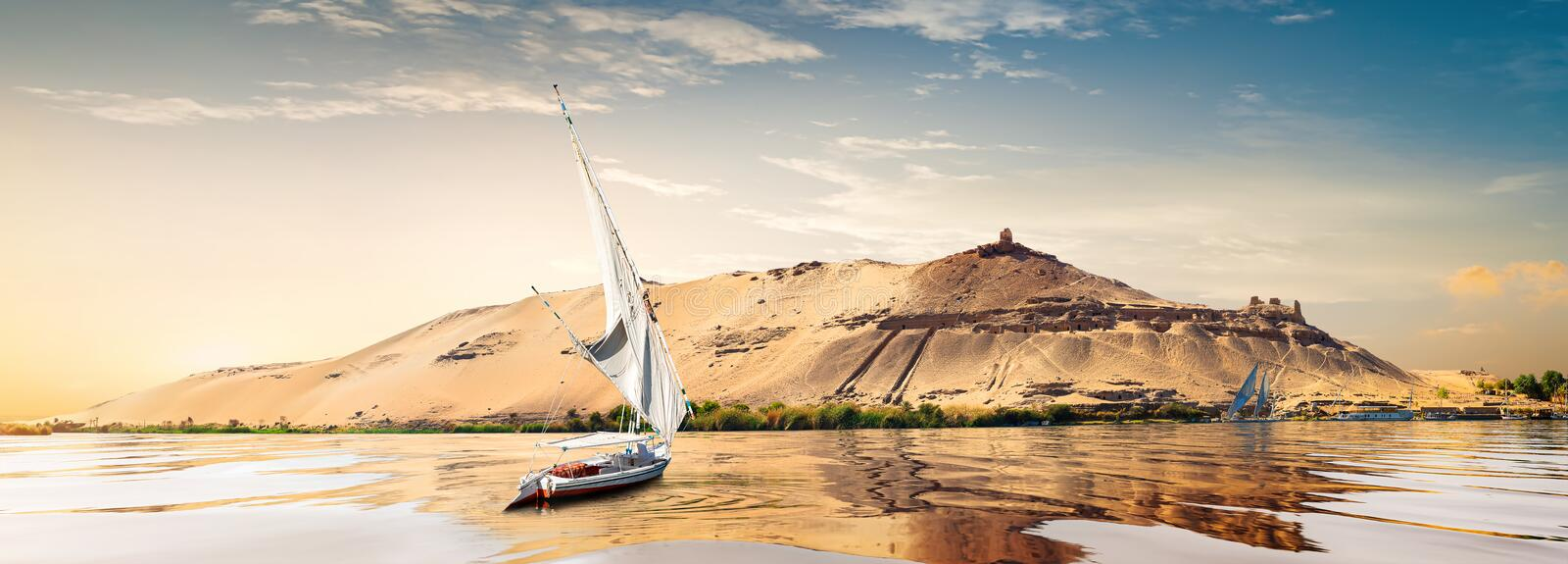 Sunset in Aswan. River Nile and boats at sunset in Aswan royalty free stock photo