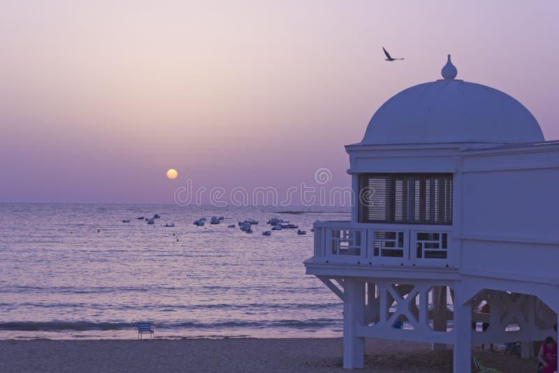 Sunset in Atlantic beach. Andaluscía, Spain. stock photo