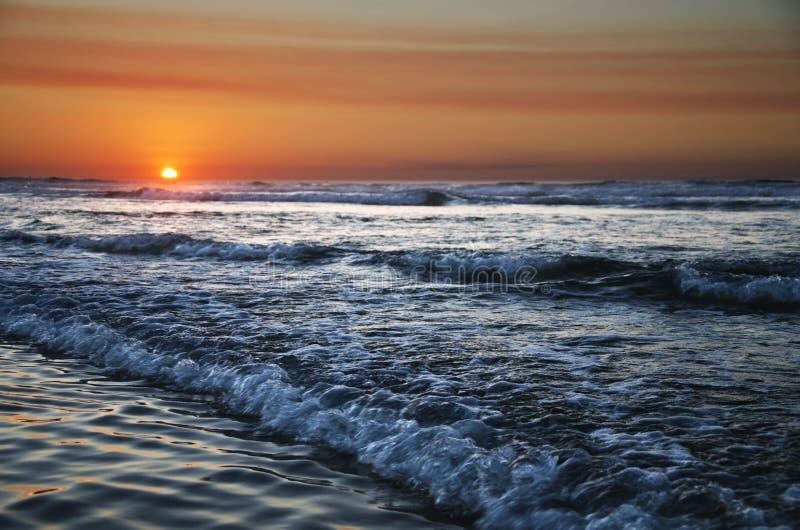 Sunset on atlantic coast stock photography