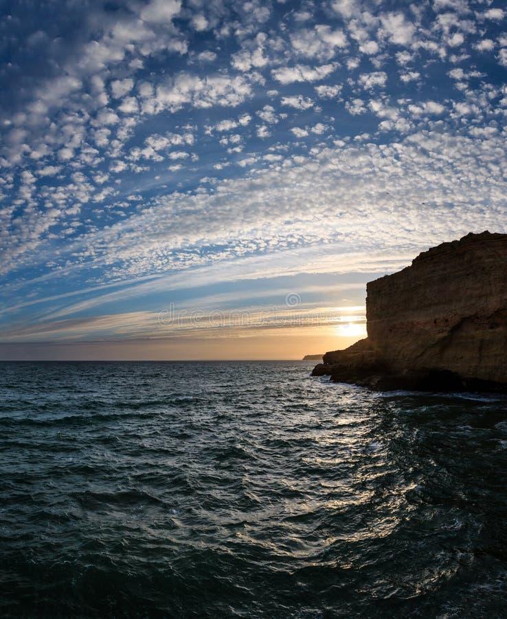 Sunset Atlantic rocky coastline, Algarve, Portugal. Sunset Atlantic rocky coastline view Lagoa district, Algarve, Portugal stock images