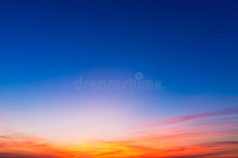 Sunset background with blue, red and yellow colors.  stock photo