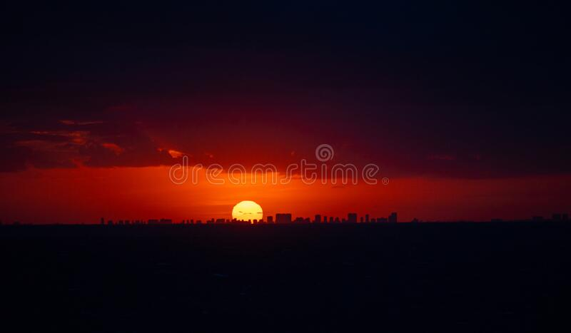 Sunset on the background of the city stock images