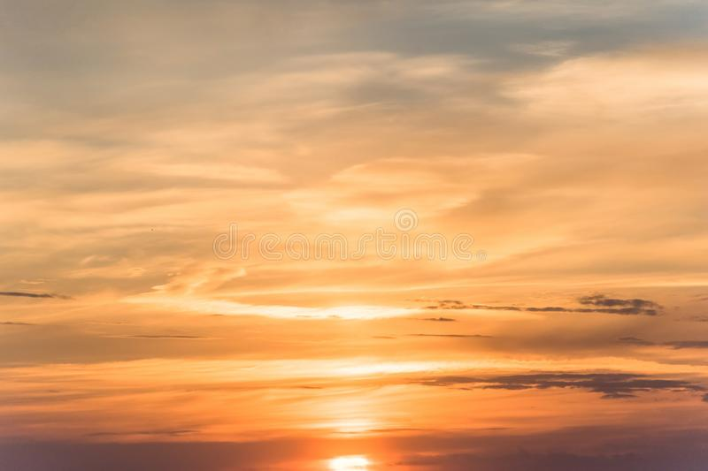 Sunset background. sky with soft and blur pastel colored clouds.  gradient cloud on the beach resort. nature. sunrise.  peaceful m royalty free stock photo