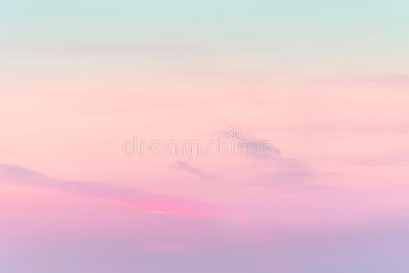 Sunset background. sky with soft and blur pastel colored clouds.  gradient cloud on the beach resort. nature. sunrise.  peaceful m. Orning. Instagram toned style stock photo