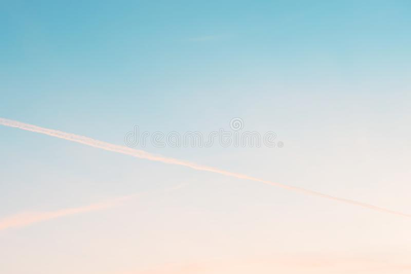 Sunset background. sky with soft and blur pastel colored clouds.  gradient cloud on the beach resort. nature. sunrise.  peaceful m. Orning. Instagram toned style royalty free stock image