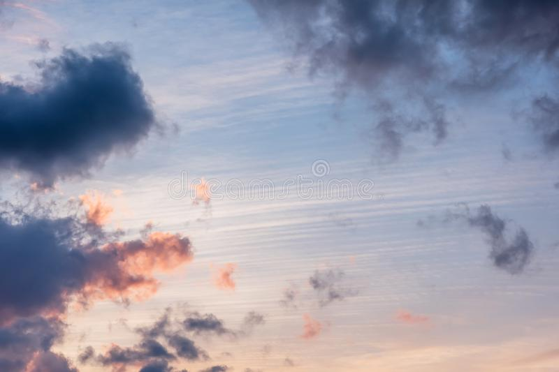 Sunset background. sky with soft and blur pastel colored clouds.  gradient cloud on the beach resort. nature. sunrise.  peaceful m. Orning. Instagram toned style stock photography