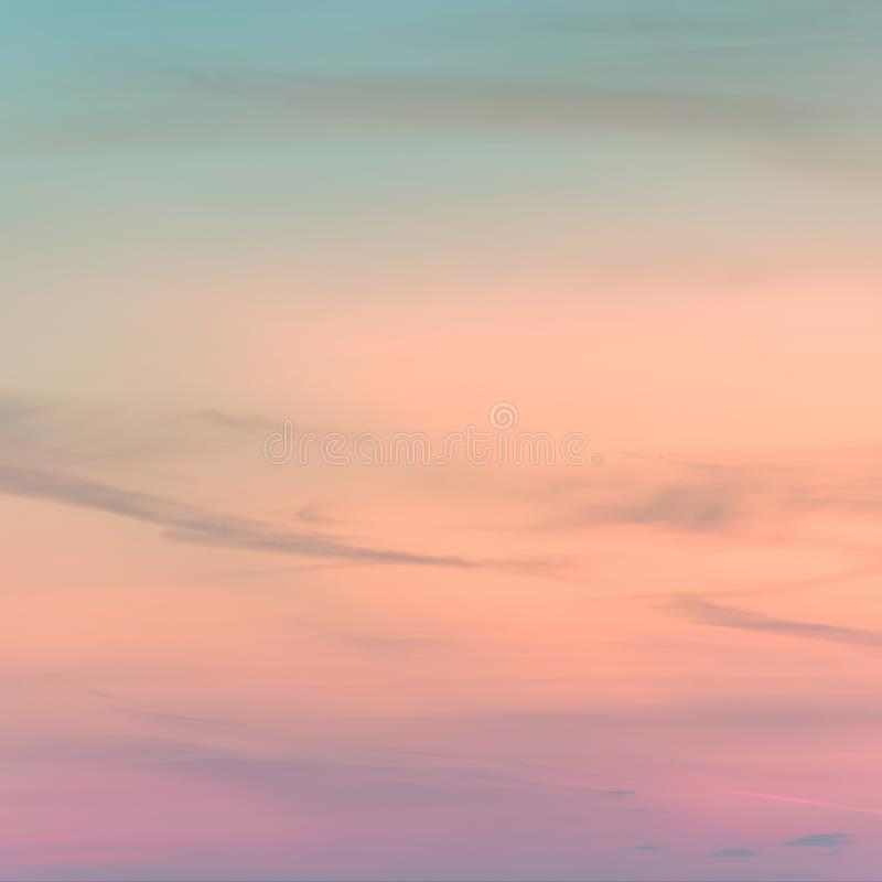Sunset background. sky with soft and blur pastel colored clouds. gradient cloud on the beach resort. nature. sunrise.  peaceful. Morning. Instagram toned style stock photography