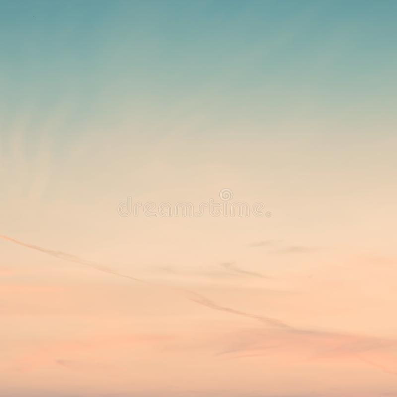 Sunset background. sky with soft and blur pastel colored clouds. gradient cloud on the beach resort. nature. sunrise.  peaceful. Morning. Instagram toned style royalty free stock image