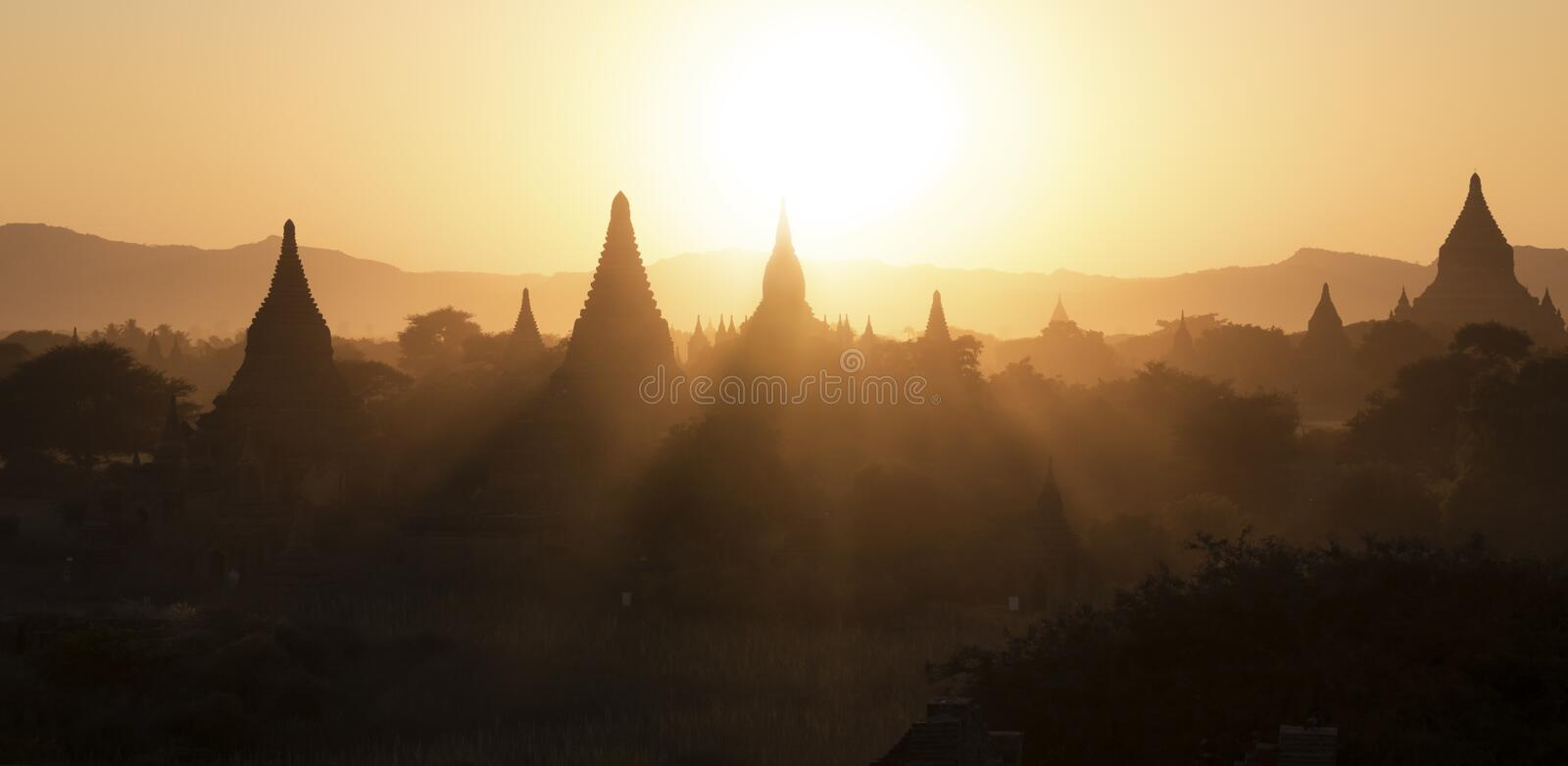 Sunset at the Bagan landscape. Silhouettes of the Bagan stupas during sunset, Myanmar stock image