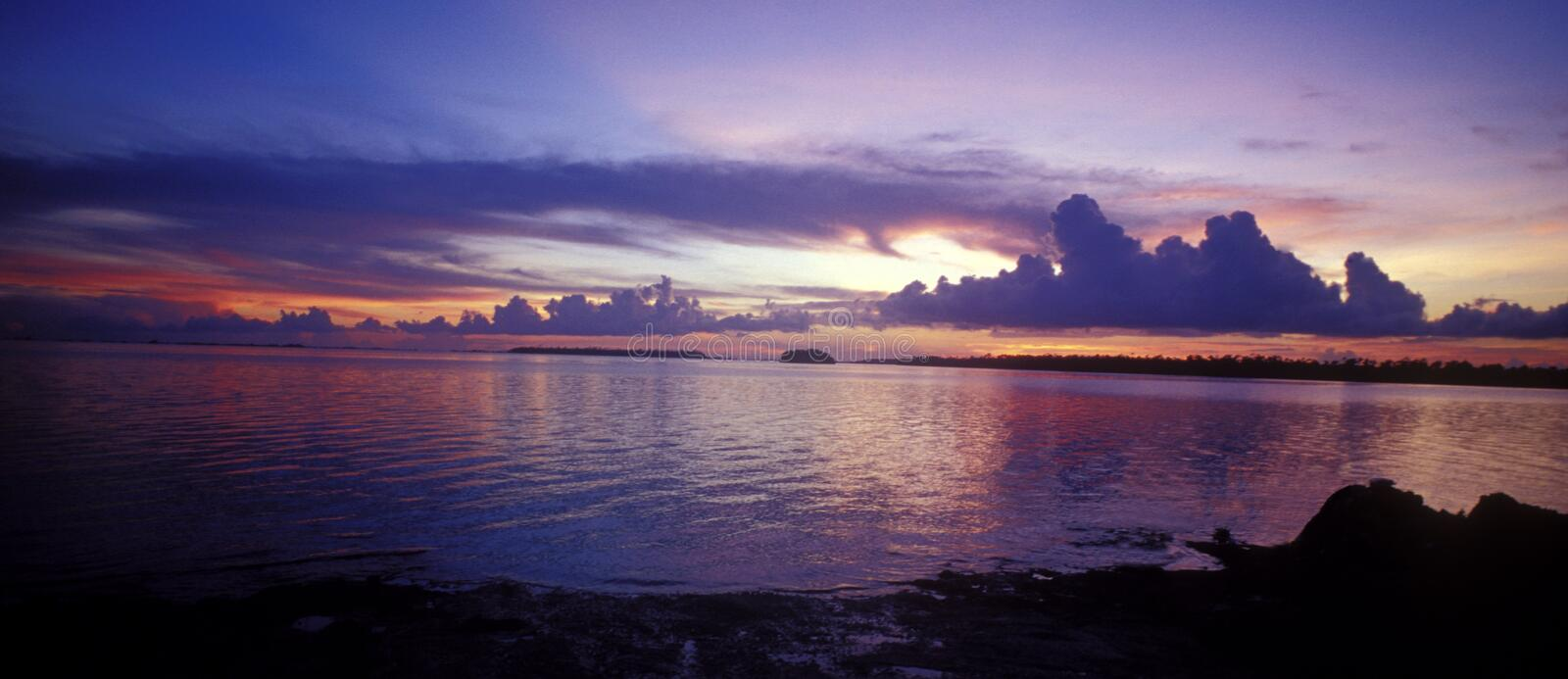 Sunset in the Bahamas. A panoramic view of a dramatic sunset in Abaco, Marsh Harbour, Bahamas. The sky is purple royalty free stock images