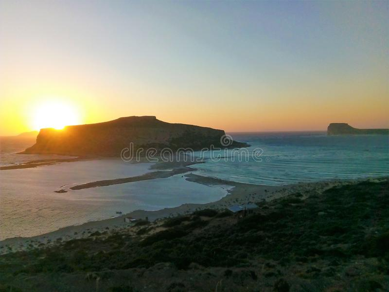Sunset at Balos. View of the sunset the mountain next to Balos beach, in Crete stock image