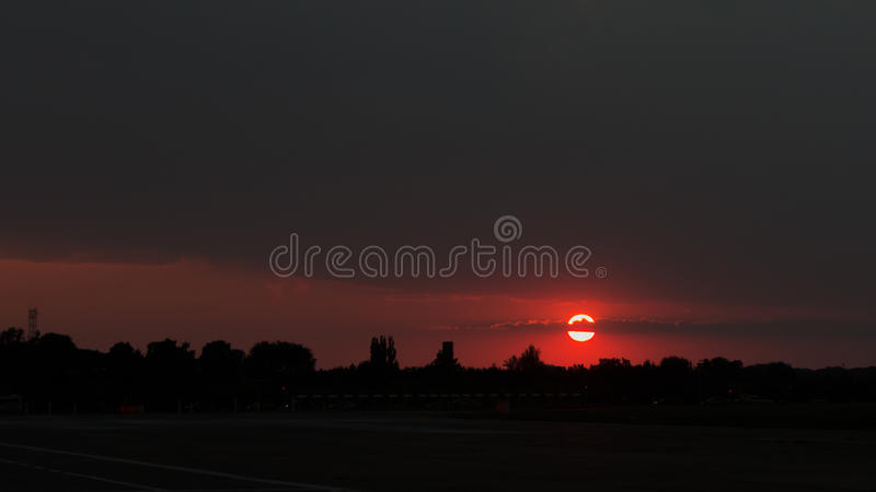 Sunset at Baneasa Airport. The sunset during Bucharest International Air Show 2013 royalty free stock photos
