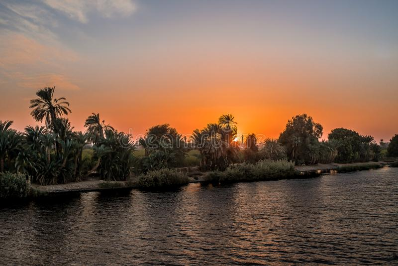 Sunset at the bank of river Nile royalty free stock photo