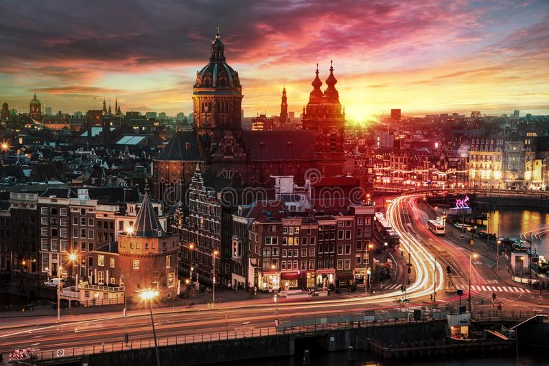 Basilica Saint Nicolas. Sunset on the basilica Saint Nicolas church in Amsterdam sunset skyline with the traffic light trays, Netherlands stock image