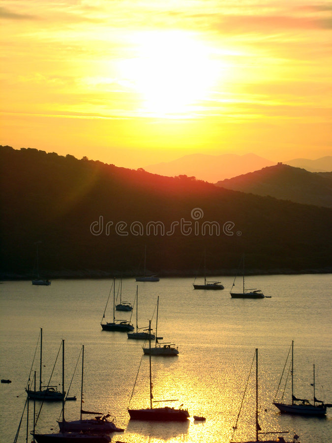 Sunset in bay stock image