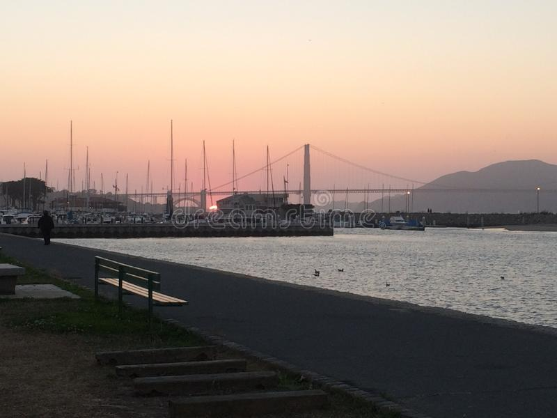 Sunset by the bay royalty free stock photo