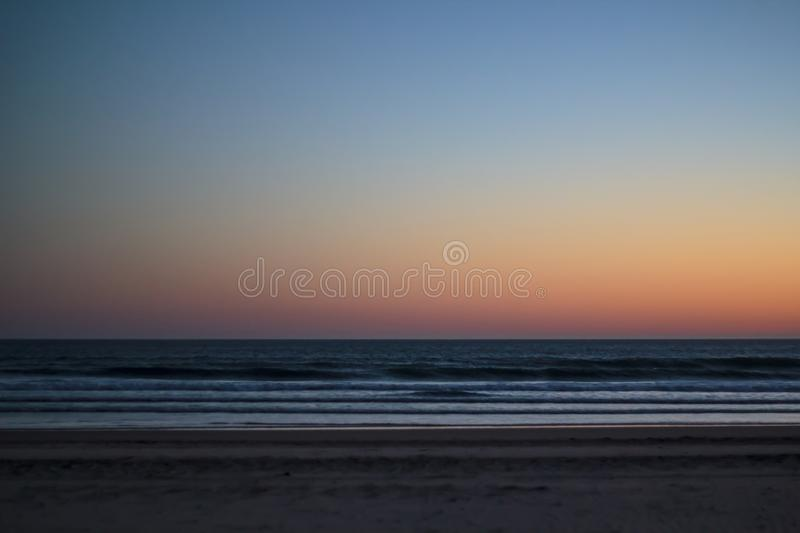 Sunset on the beach. Landscape royalty free stock photography