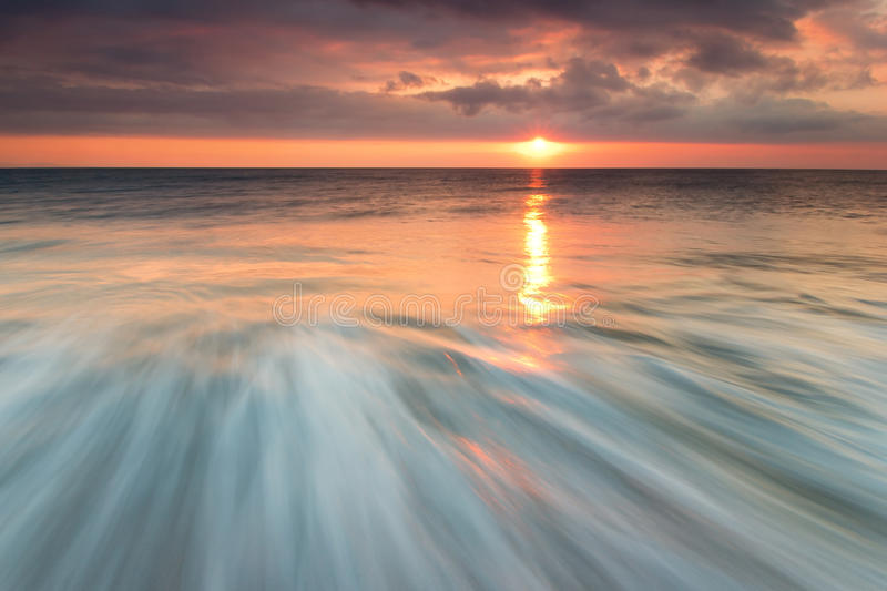 Sunset at the beach royalty free stock images