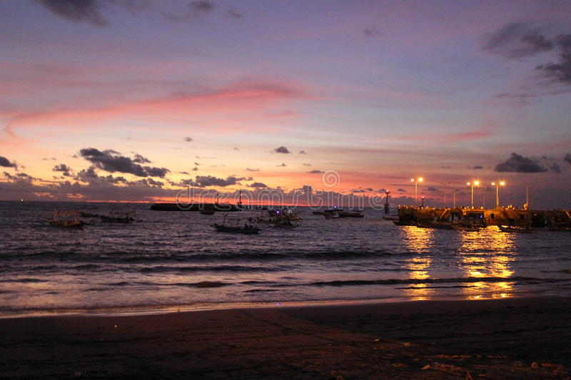Sunset on the beach in bali royalty free stock photos