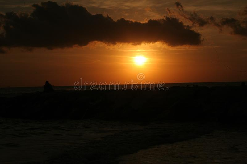 The sunset at the beach. A beautiful cloudy sunny day but at the end of the day there was a very nice sunset royalty free stock photos