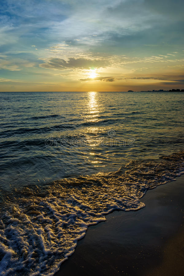 Sunset by the beach stock image