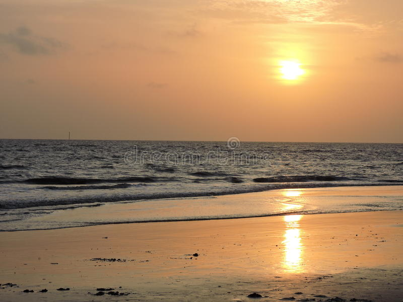 Sunset on a beach royalty free stock photos