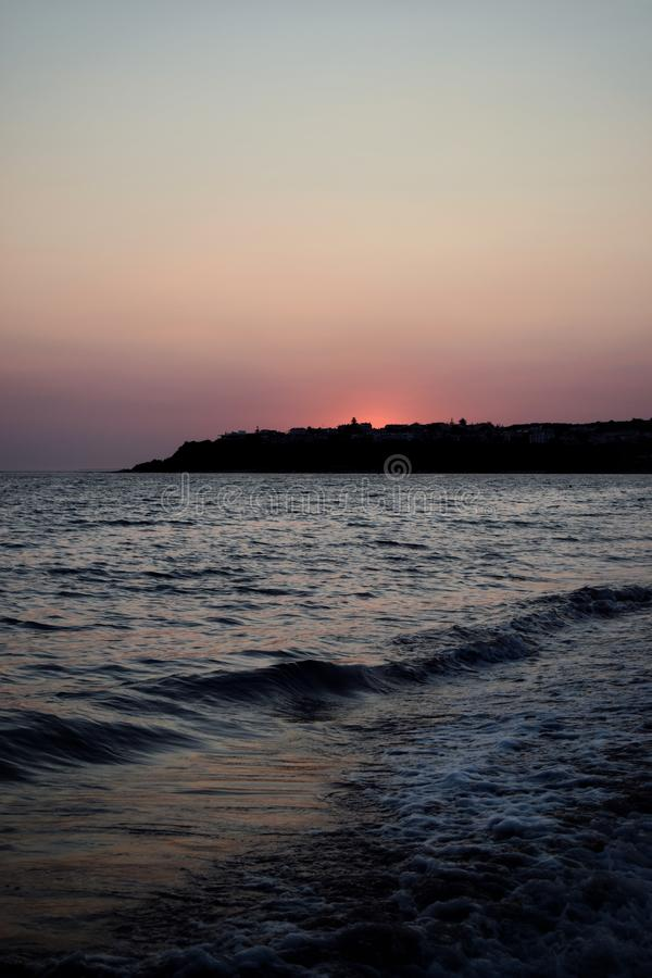 Sunset at the beach. Beautiful, pink, sea, waves, summer royalty free stock photo