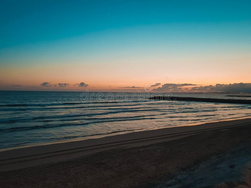 Sunset at beach stock images