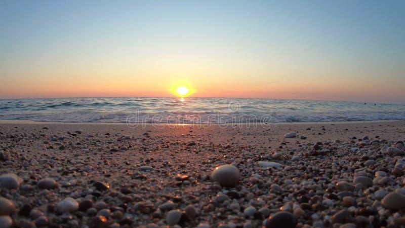 Sunset on the beach. Sunset on the blue sea beach stock photo