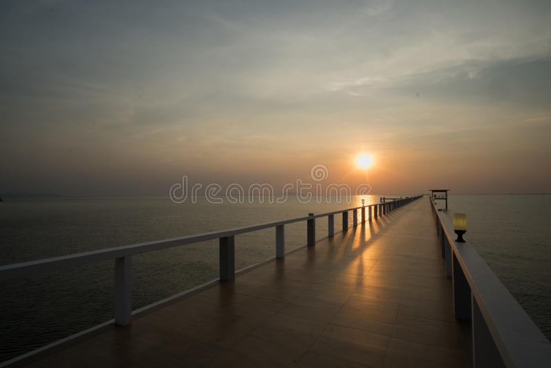 Sunset on beach and bridge royalty free stock photos