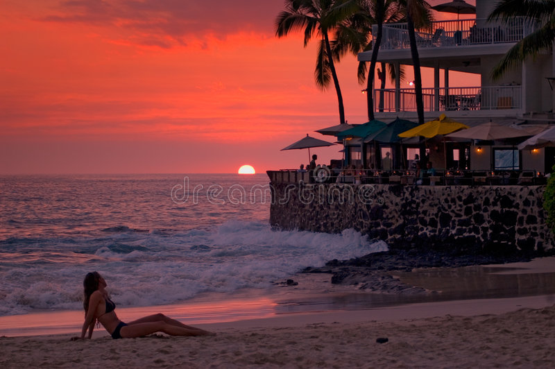 Sunset at the beach, cafe royalty free stock photo