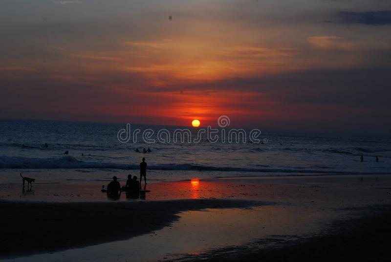 Sunset at the beach in canggu bali ocean stock images