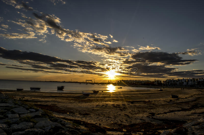 Sunset at the beach stock photography