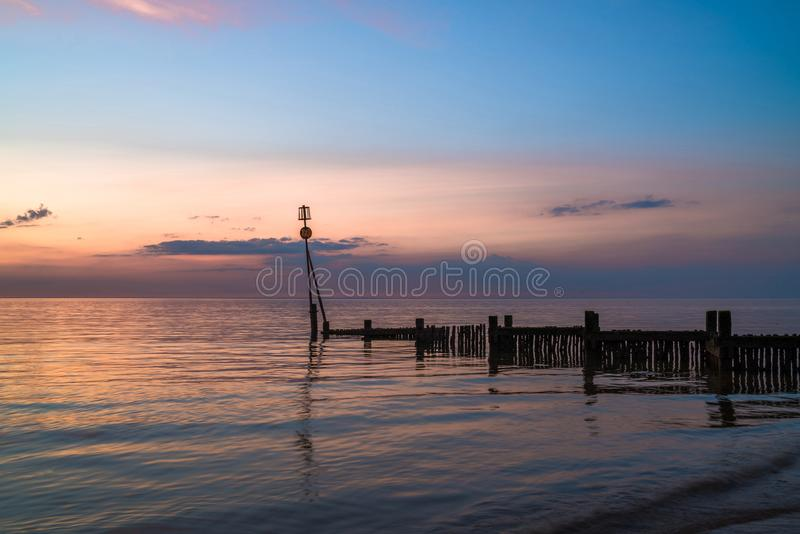 Sunset on the beach in Hunstanton, Norfolk, UK royalty free stock photography