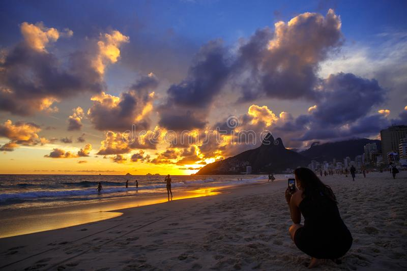 Sunset on the Ipanema. Water, mountain and sky. royalty free stock images