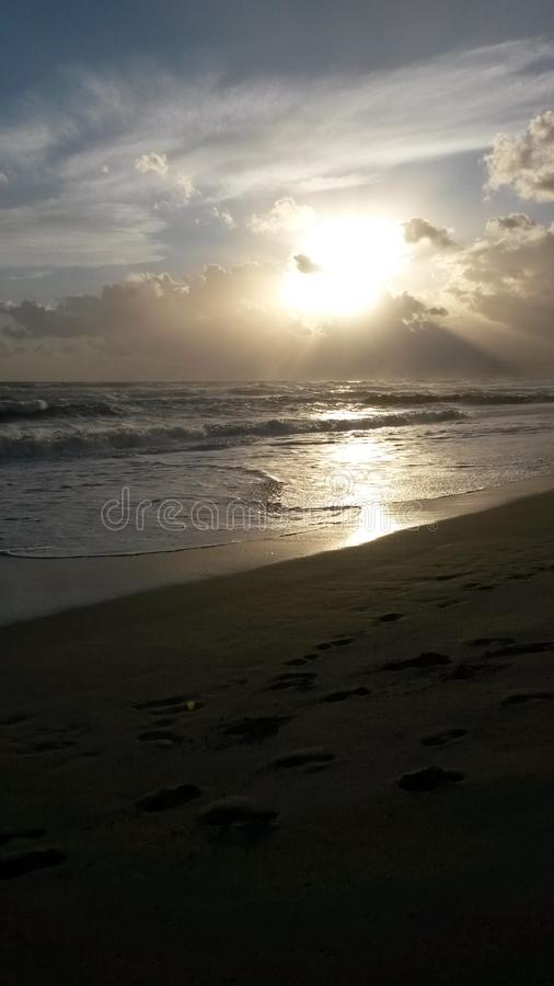 The sunset at the beach in Italy. These are the best moments of the day. The sunset. Nice colors. The sun goes down. The clouds . The light. Water and the sea royalty free stock photo