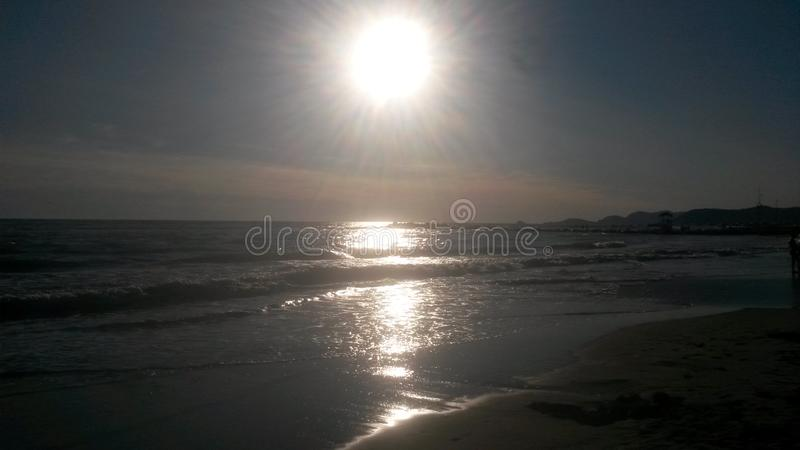 The sunset at the beach in Italy. These are the best moments of the day. The sunset. Nice colors. The sun goes down. The clouds . The light. Water and the sea stock photography