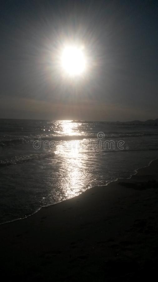 The sunset at the beach in Italy. These are the best moments of the day. The sunset. Nice colors. The sun goes down. The clouds . The light. Water and the sea stock photos