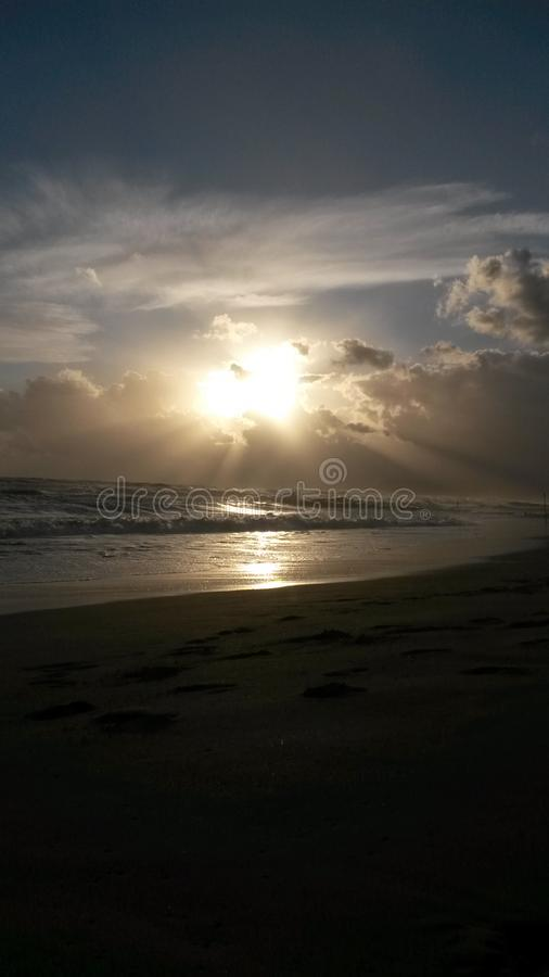 The sunset at the beach in Italy. These are the best moments of the day. The sunset. Nice colors. The sun goes down. The clouds . The light. Water and the sea royalty free stock photos
