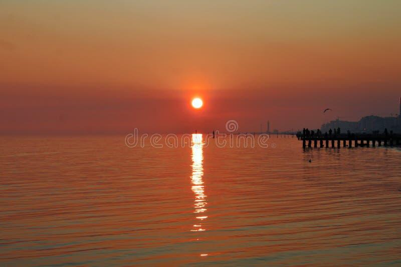 Sunset on the beach, italy jesolo. Sunset on the beach, italy jesolo stock photos