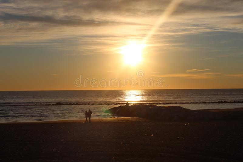 The sunset at the beach in Italy on a winter day. The sunset at the beach on a winter day. The sun was shining on this beautiful afternoon. The colours came out stock photos