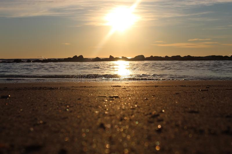 The sunset at the beach in Italy on a winter day. The sunset at the beach on a winter day. The sun was shining on this beautiful afternoon. The colours came out royalty free stock photo