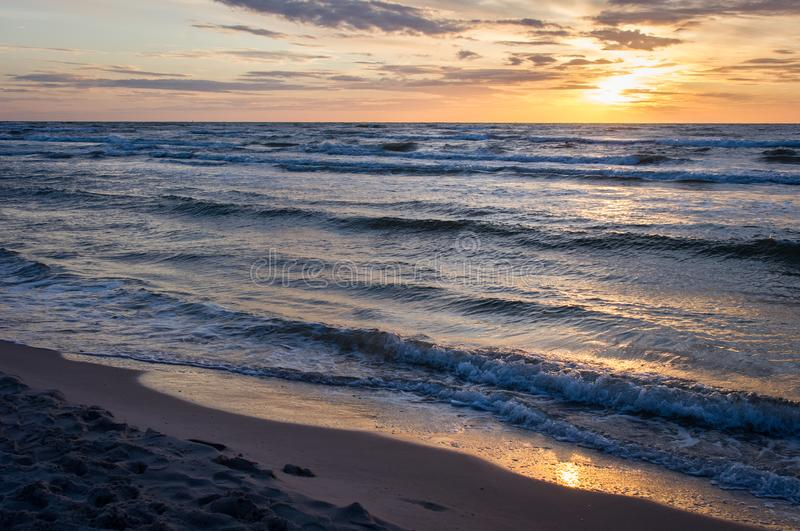 Sunset on beach in Leba, Baltic Sea, Poland. royalty free stock images