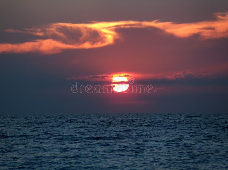 Sunset on the beach of Lefkada island, sun sea impressive colors royalty free stock photos