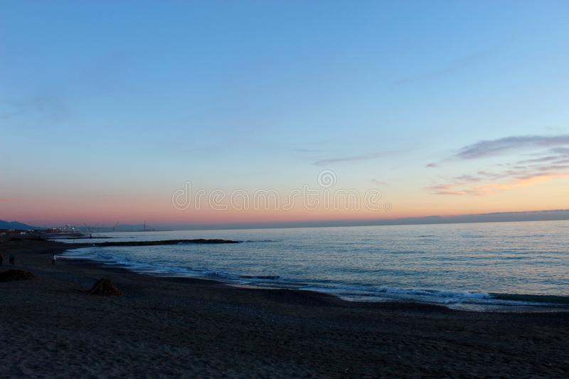 Sunset at the beach in Marinella di Sarzana. A beautiful cold afternoon in autumn at the beach in Italy. Looking at the sunset. The sun was slowly going down royalty free stock photos