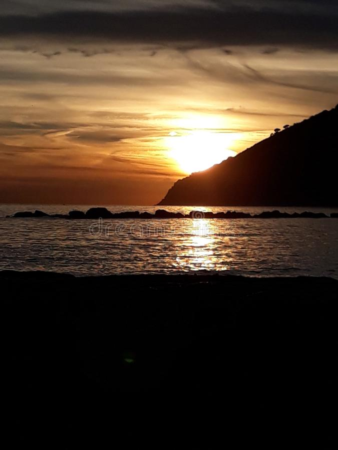 Sunset at the beach in Marinella di Sarzana. A beautiful cold afternoon in autumn at the beach in Italy. Looking at the sunset. The sun was slowly going down royalty free stock photography