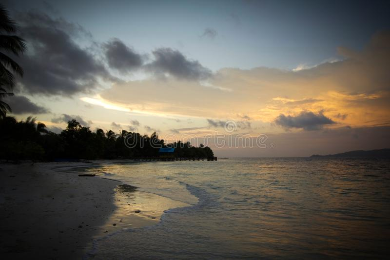 Sunset by the beach in raja ampat archipelago. West papua royalty free stock images