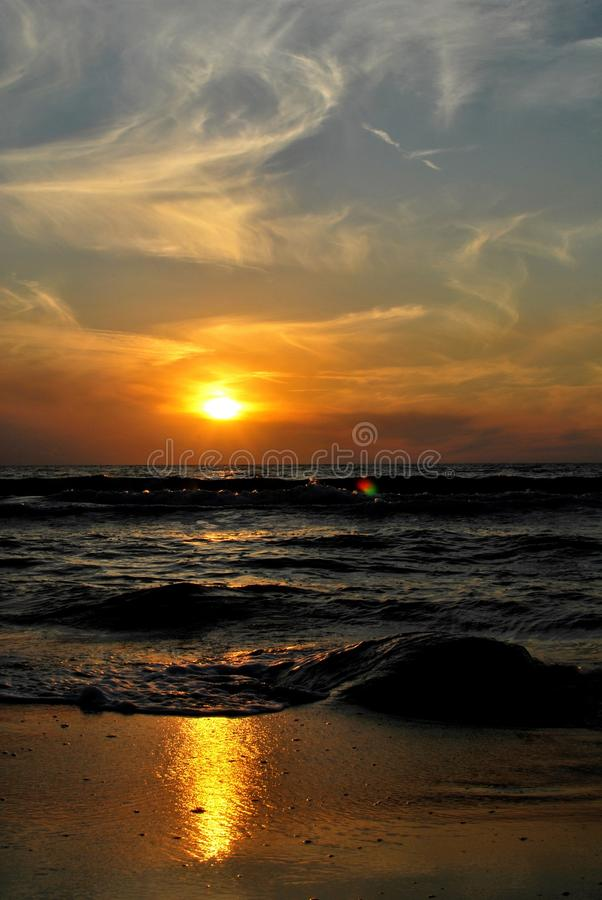 Sunset. The sunset on the beach - romantic place royalty free stock photos
