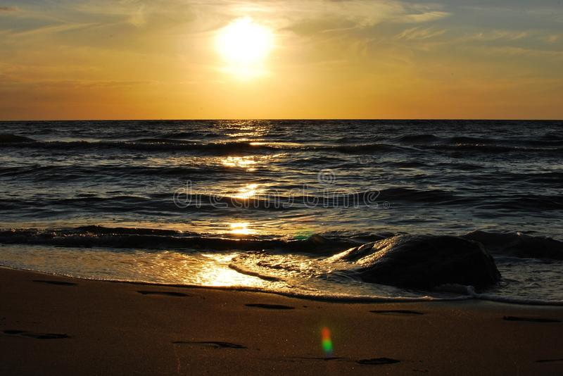 Sunset. The sunset on the beach - romantic place stock images